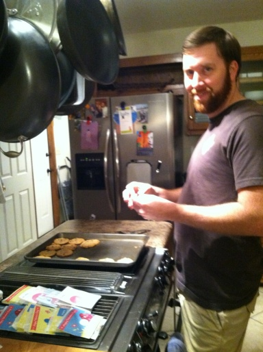 Hubby helps make wax-paper pockets to hold the cookies